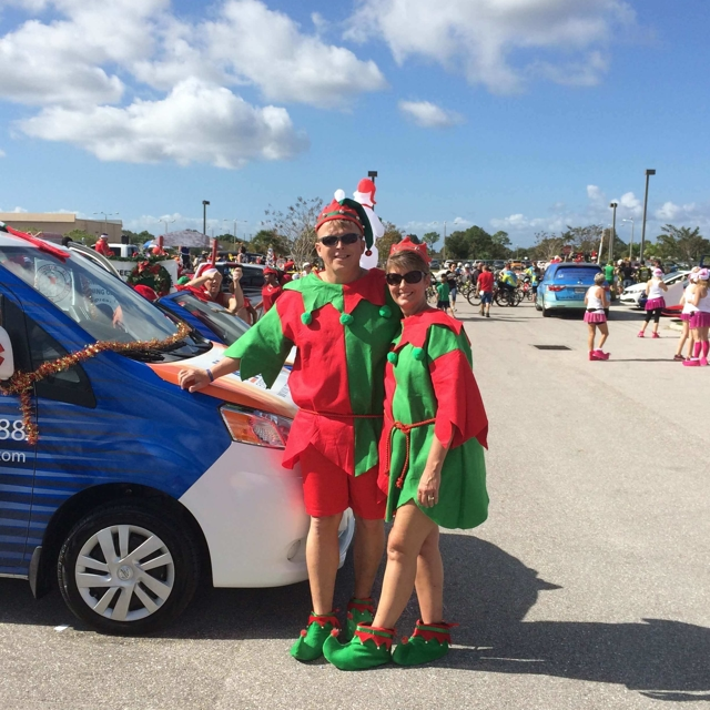 Two Elves near a car