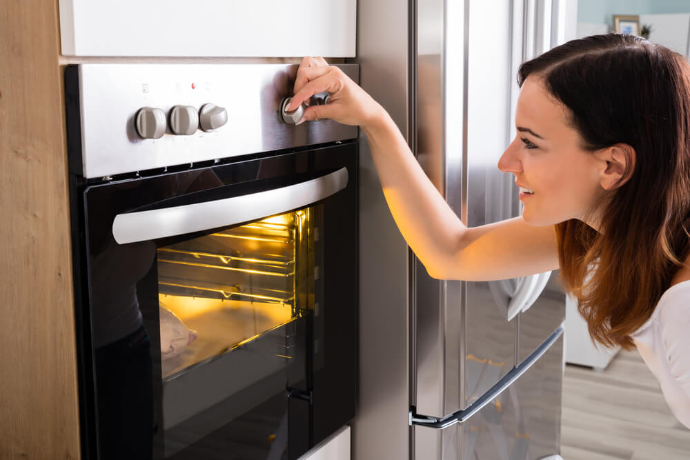 Woman Turning Notch on Oven