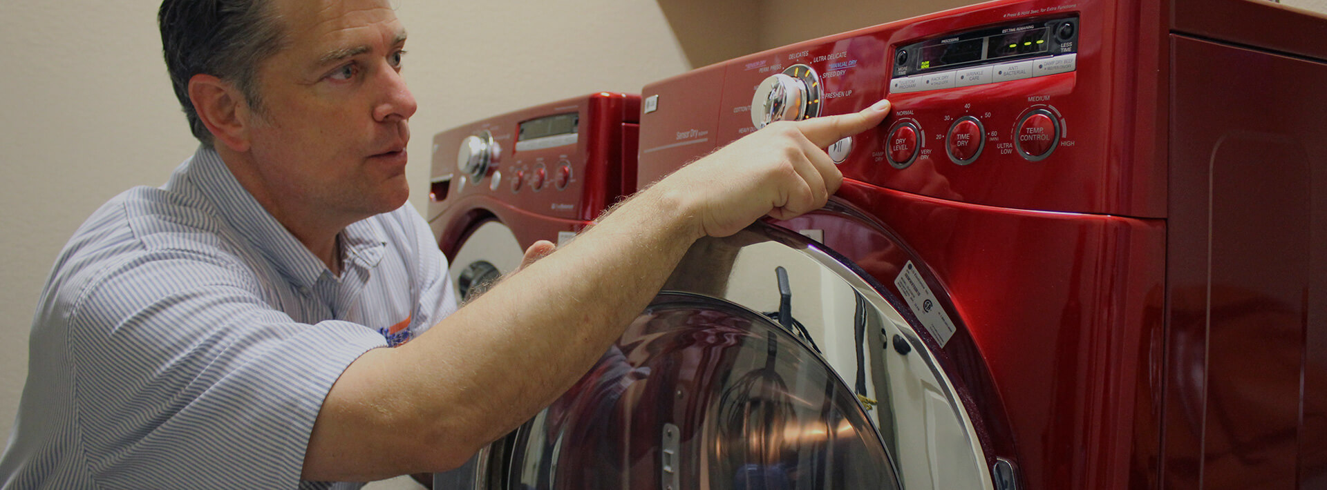 Mr. Appliance tech looking at a dryer