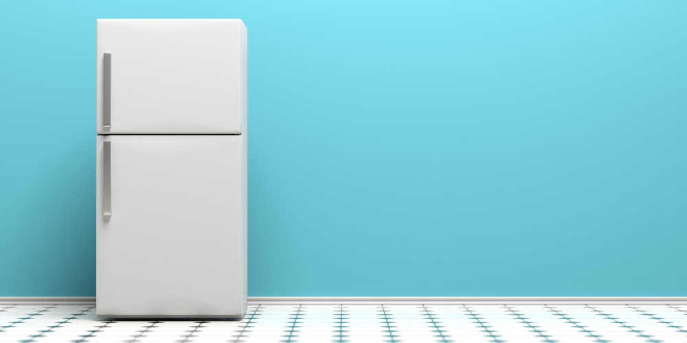 White refrigerator with blue wall